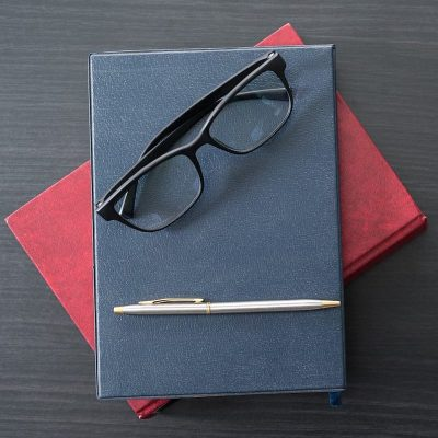 glasses-and-book-on-the-wood-desk-4-B4GD7KR